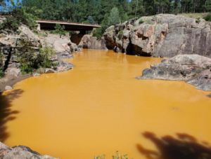 Making cold climate gold mine water effluent safe for fish